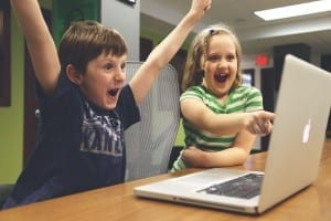 Kids Cheering at the laptop