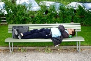 Man laying on a park bench